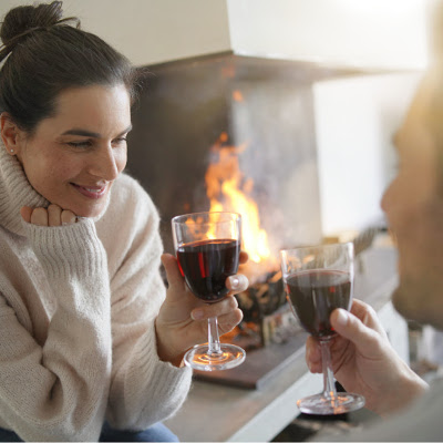 couple enjoying glass of wine indoors