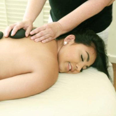 woman enjoy hot rock massage.